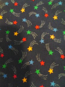 Multi-colored shooting stars on navy blue background